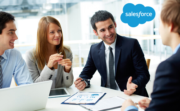 A group of 4 corporate people having a meeting to discuss about salesforce metrics of their business